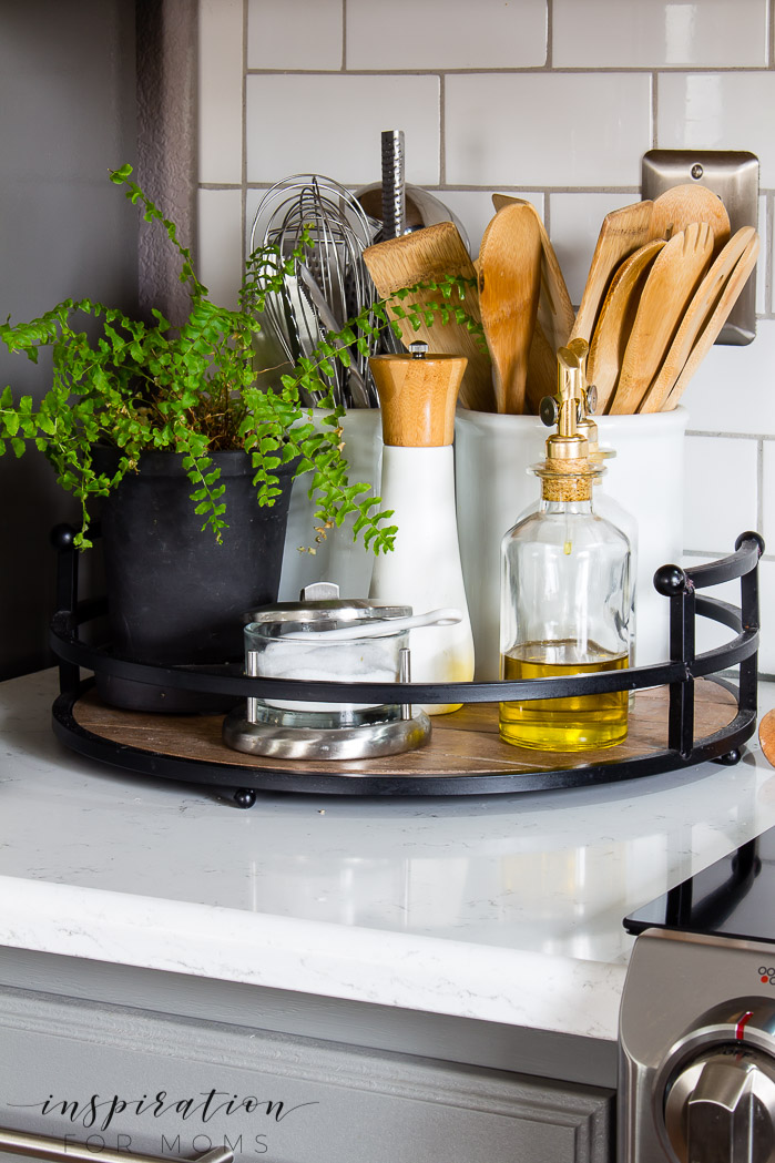 Decorating with hints of green is easy to do with the help of fresh flowers and pretty plants. wood counter tray, Quartz counters modern kitchen