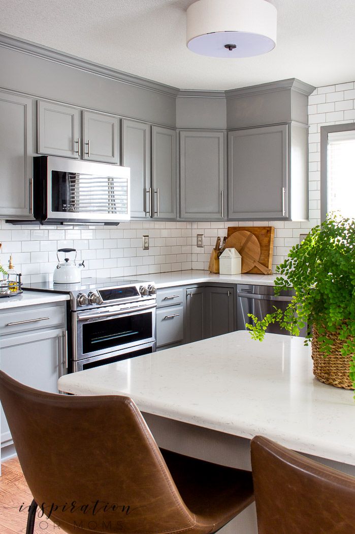 Decorating with hints of green is easy to do with the help of fresh flowers and pretty plants. maidenhair fern, Quartz counters, modern kitchen