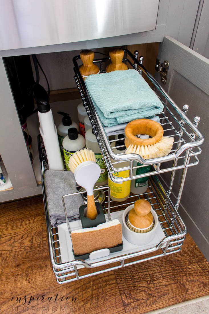 Is that cabinet under your sink a scary messy you've been ignoring? Learn helpful tips on how to organize under the kitchen sink and maintain it with ease. Under sink sliding organizer