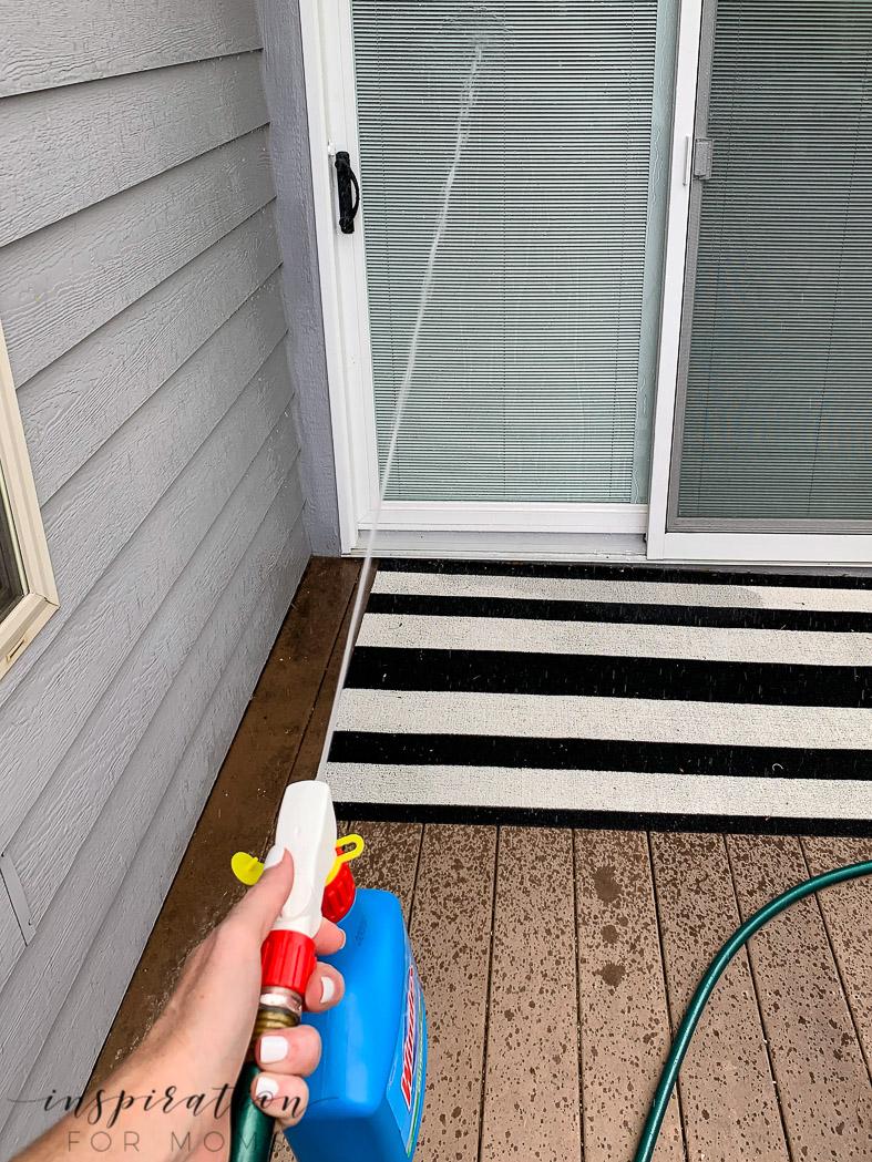 rinsing patio door with patio cleaner