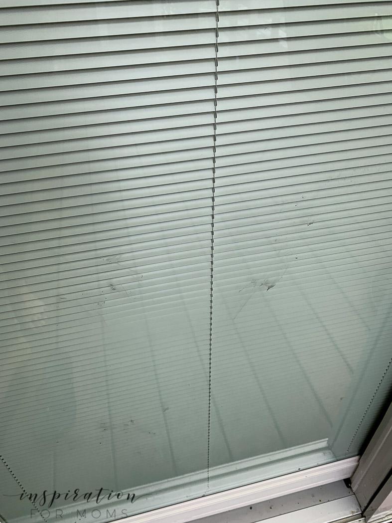 dirty patio door needs some patio cleaner