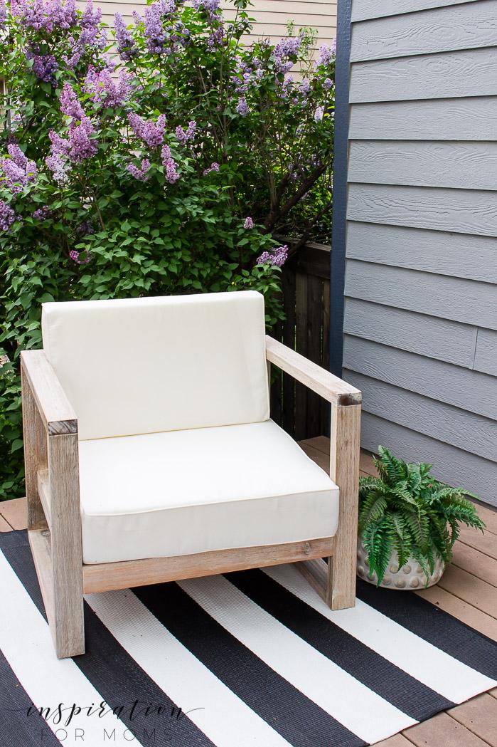 backyard patio chair on striped rug