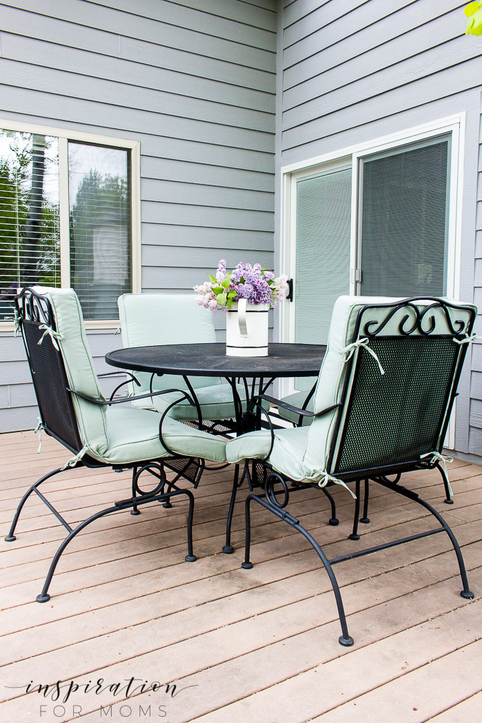 backyard patio dining table with lilacs