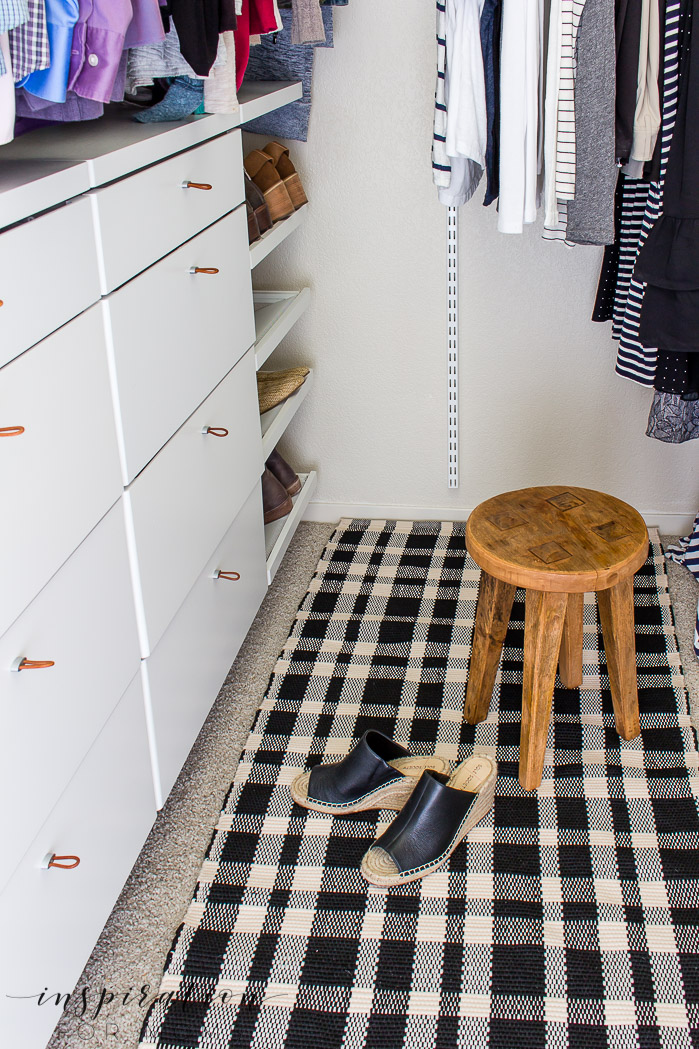 Squeeze in more items with my helpful tips and tricks on small closet organization -- rug and wood stool