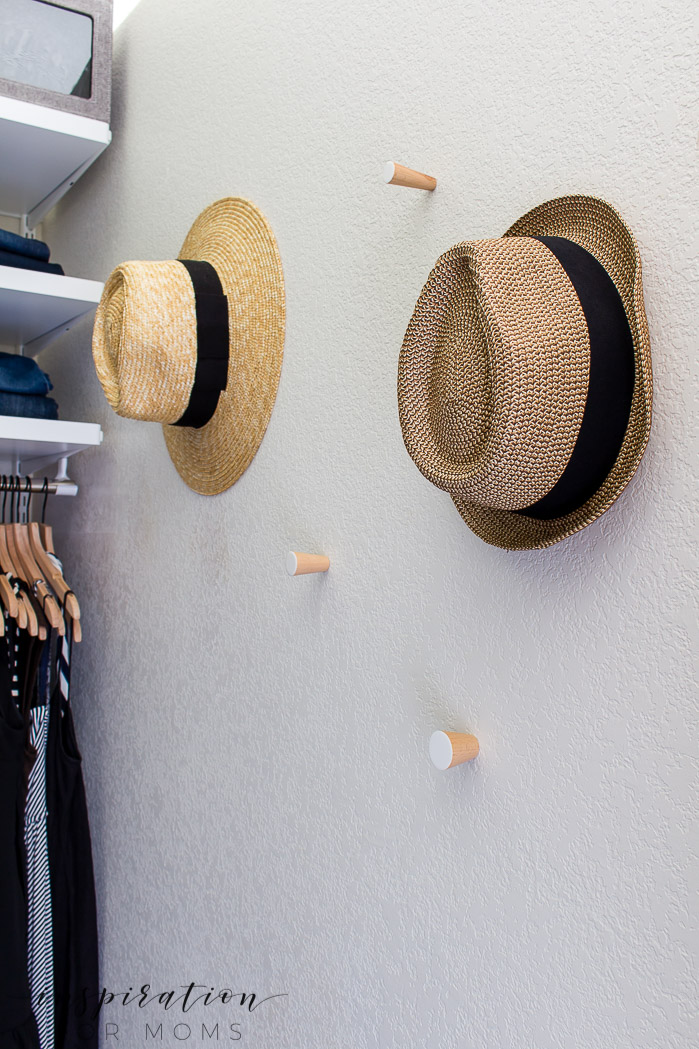 Squeeze in more items with my helpful tips and tricks on small closet organization -- hanging hats in closet