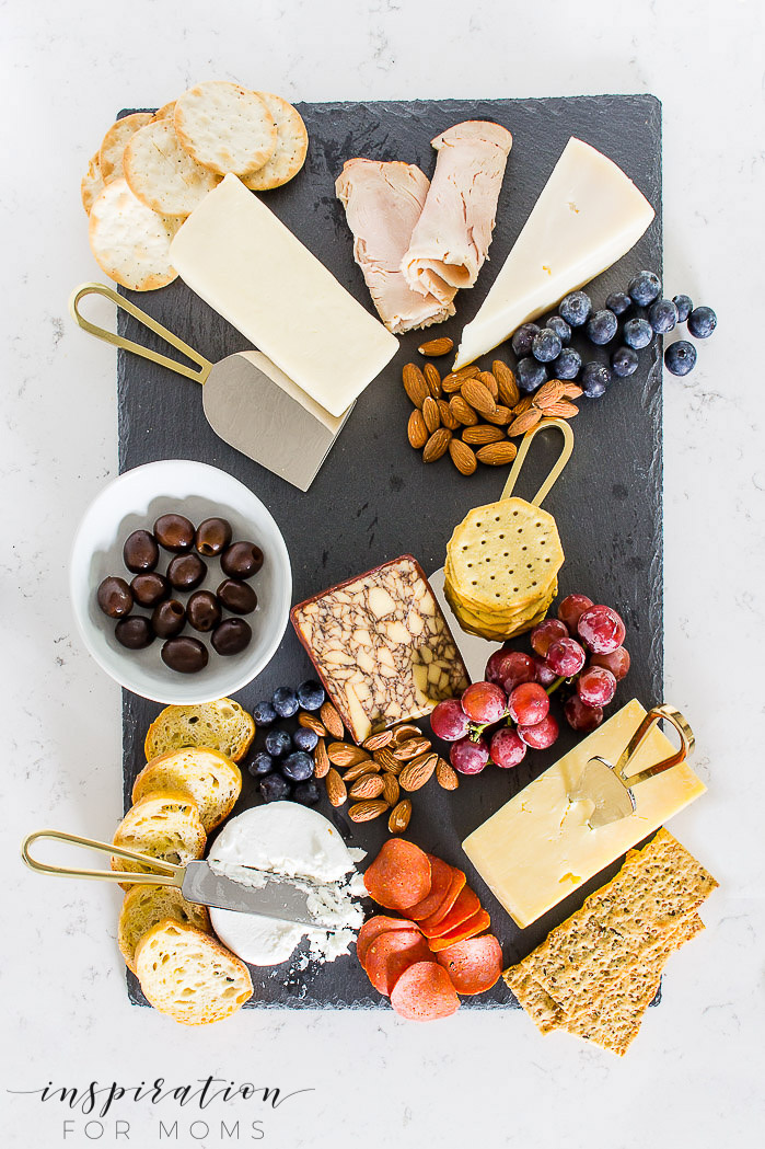 Entertain friends and family easily this summer with a fun charcuterie board. Cheese on board with crackers