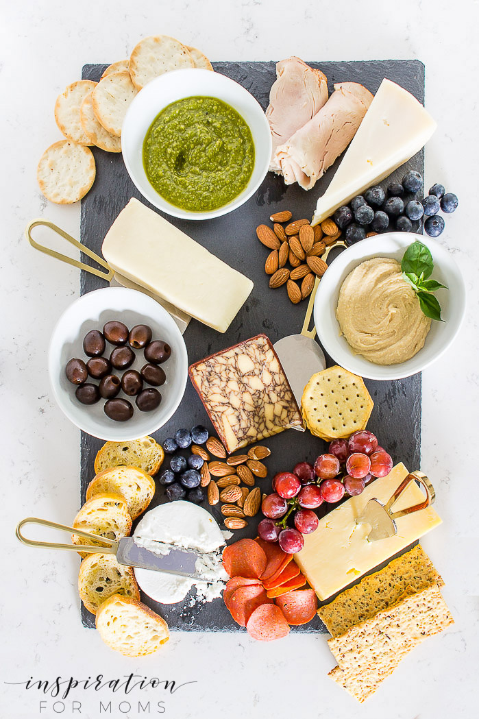 Entertain friends and family easily this summer with a fun charcuterie board. I'm teaching how to make an epic one in just seven easy steps!