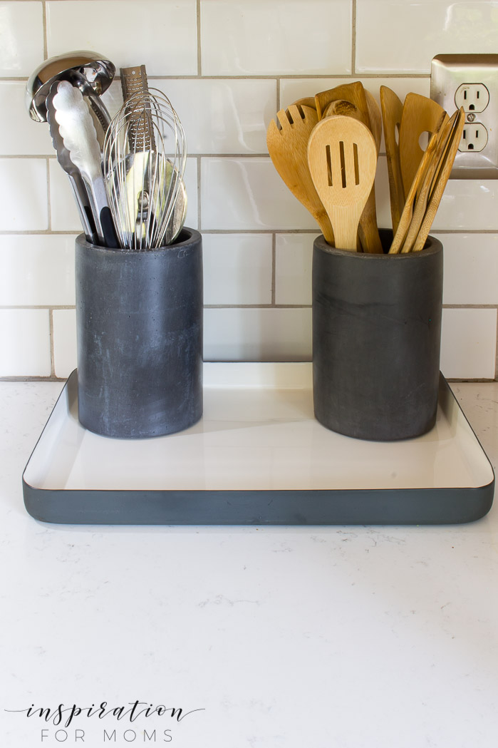 Great kitchen counter organization with white and black tray
