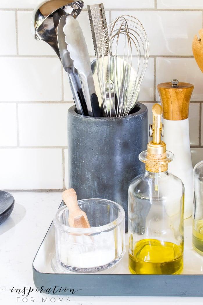 Great kitchen counter organization with concrete gray black utensil holder