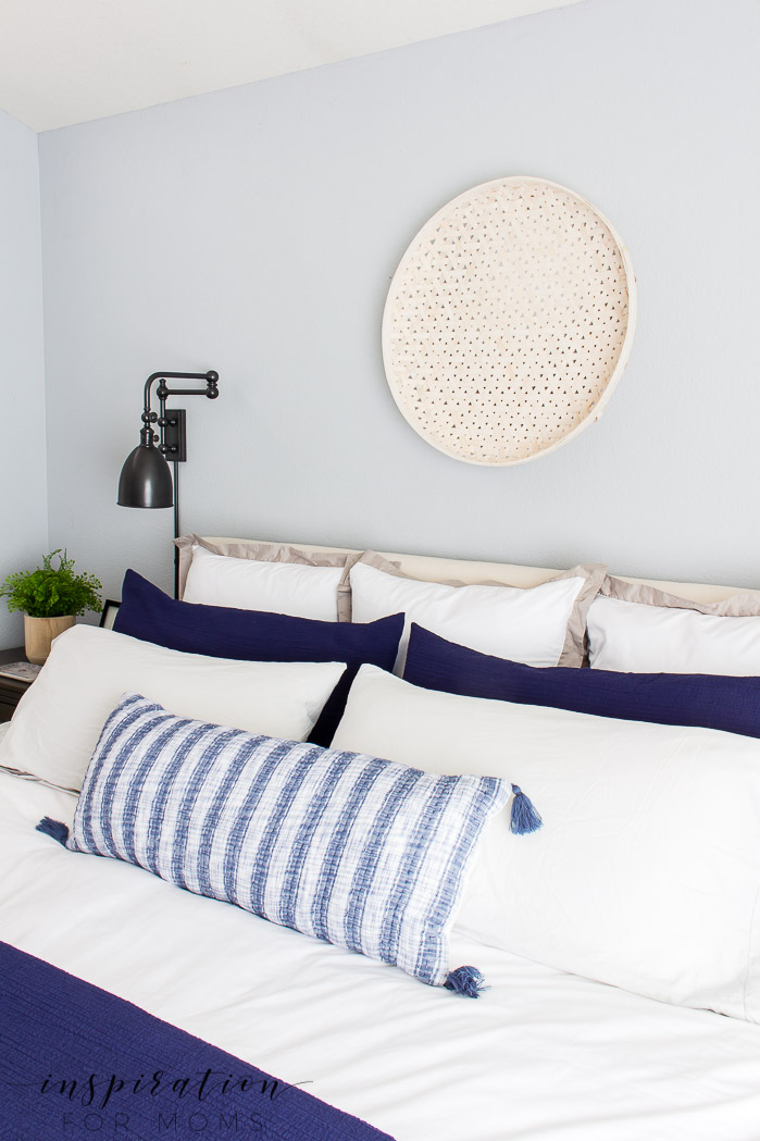 summer home tour, summer bedroom, neutral decor with navy, woven basket on wall