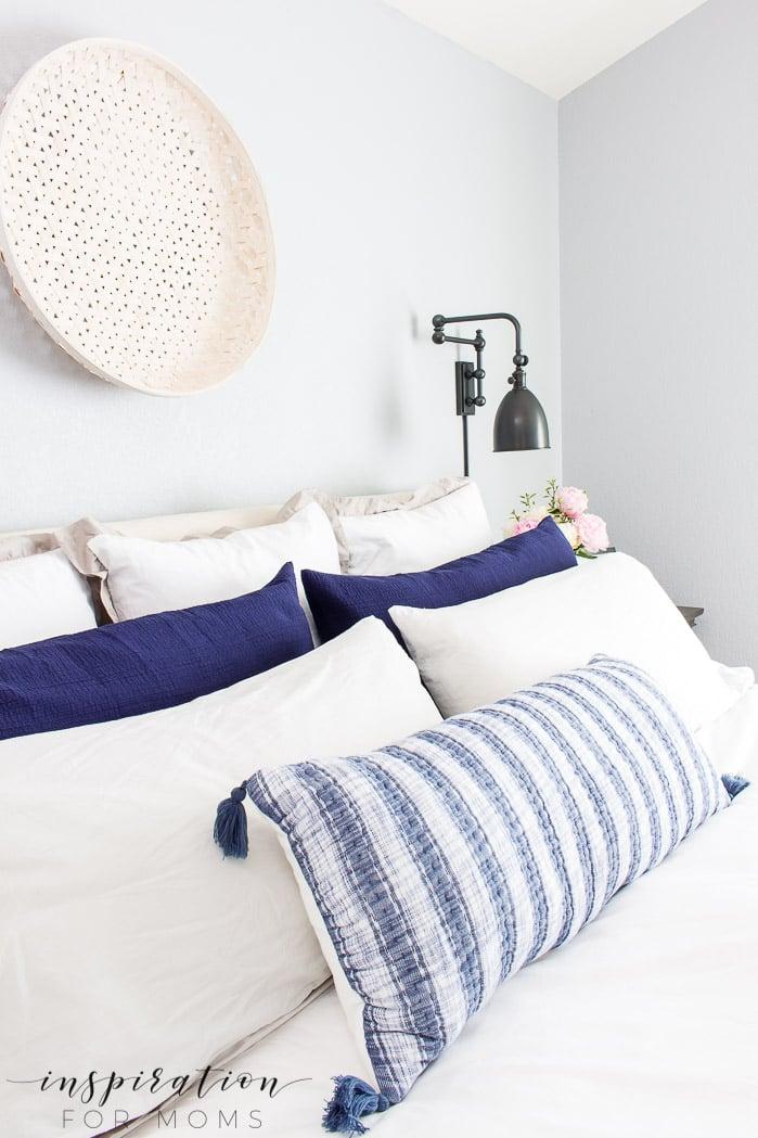 summer home tour, summer bedroom, neutral decor with navy, woven basket, striped lumbar pillow