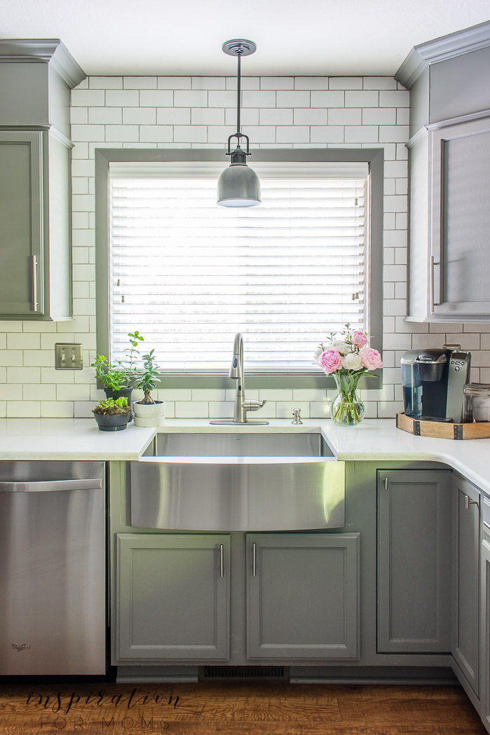 farmhouse sink with peonies and gray kitchen cabinets