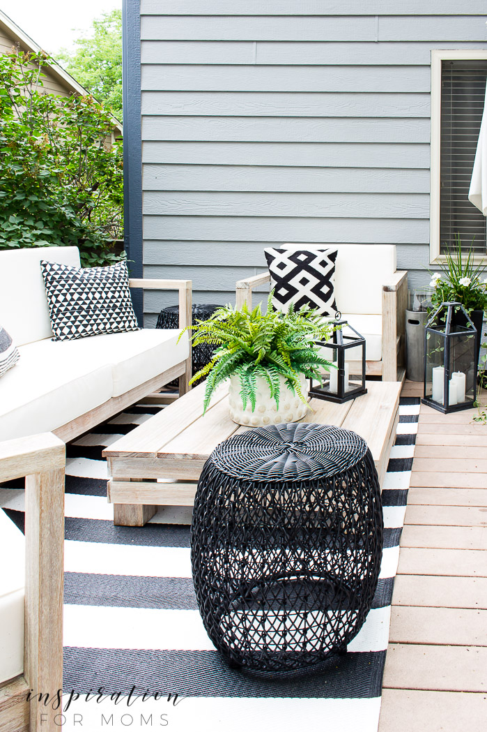 an easy outdoor living space that our family loves, outdoor furniture, black stools, lanterns, striped outdoor rug
