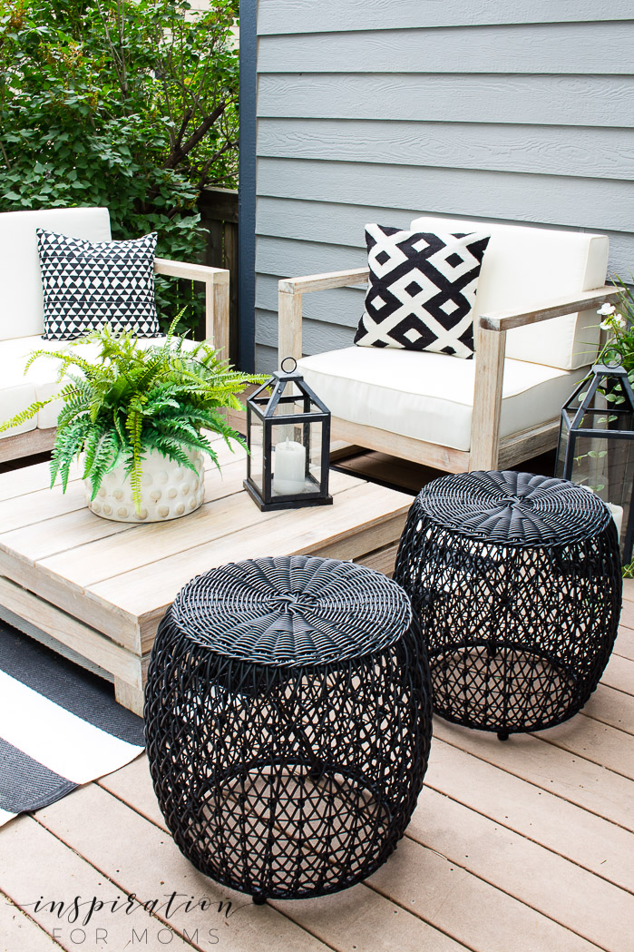 an easy outdoor living space that our family loves, outdoor furniture, black stools, lanterns