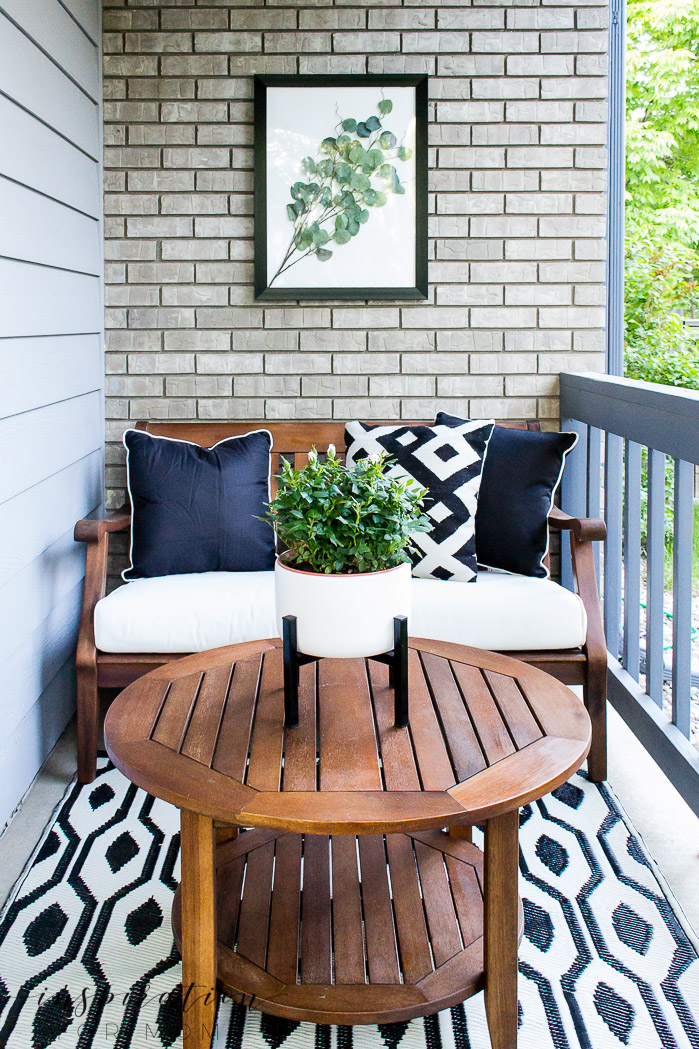 front porch seating area with black and white home decor