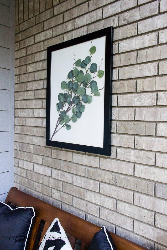 eucalyptus framed art on front porch