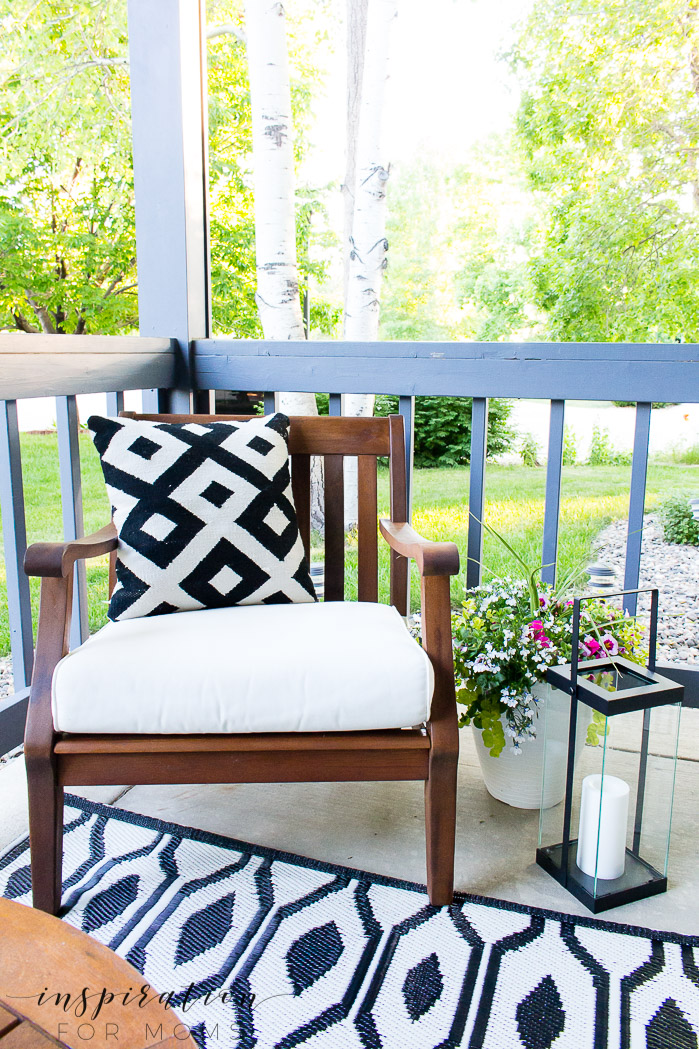 porch chair with black and white pillow and decor