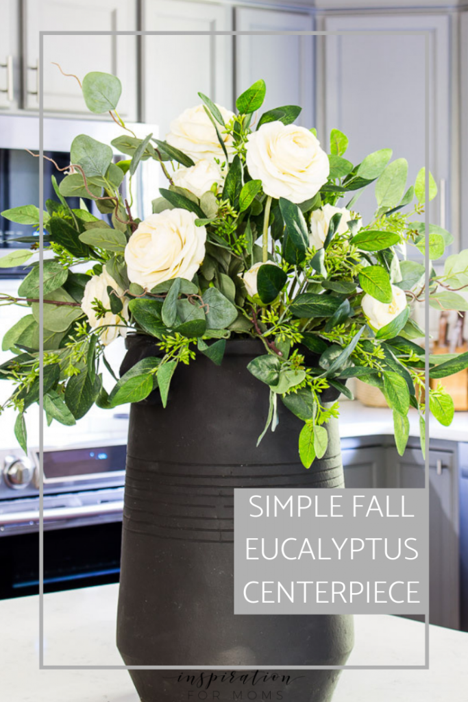 Create a simple but elegant eucalyptus fall centerpiece for a dining room table or anywhere in your home you want to add a little fall flare! #eucalyptus #fall #fallcenterpiece #falldecor #fallfloral