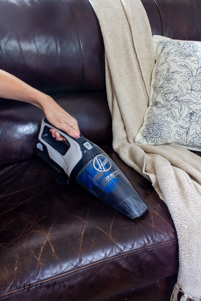 Hoover ONEPWR Hand Vacuum on couch