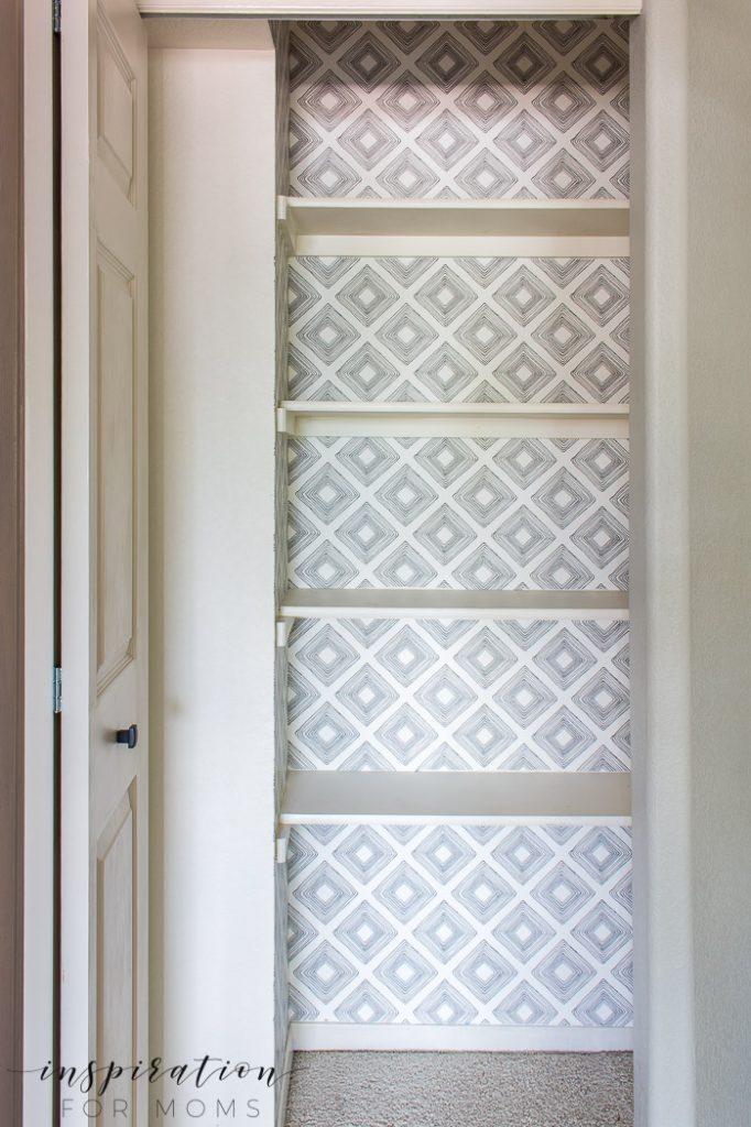 Get an organized linen closet pretty with wallpaper