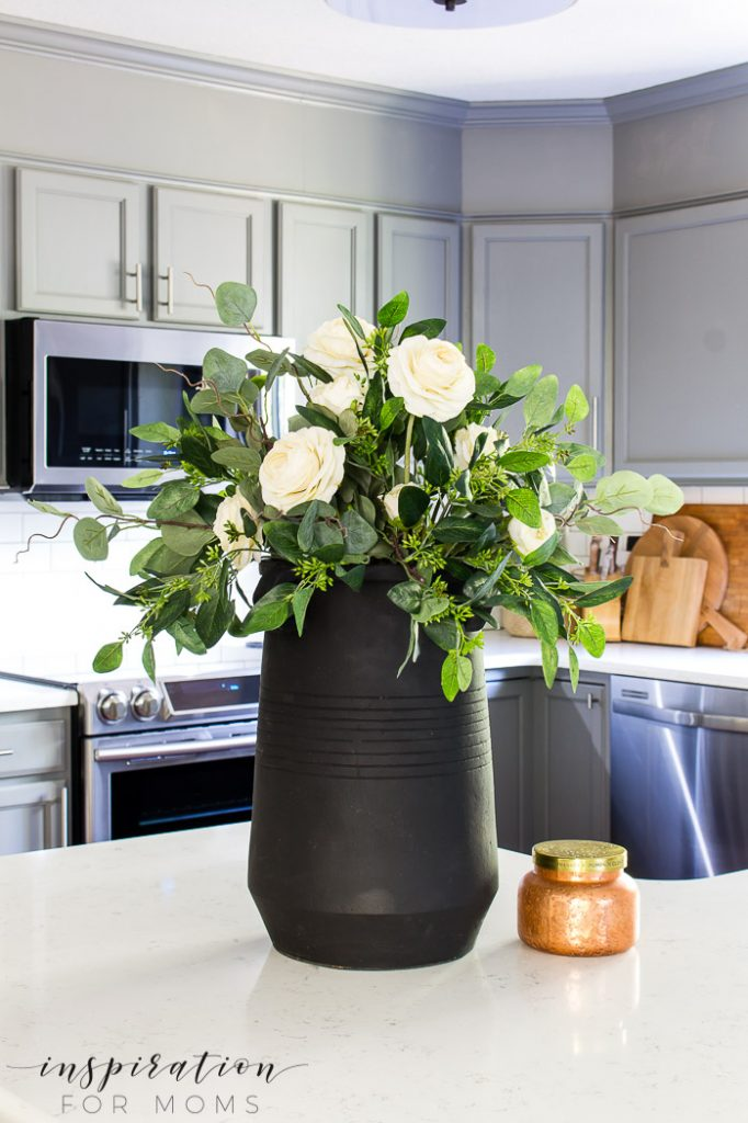 Create a simple but elegant eucalyptus fall centerpiece for a dining room table or anywhere in your home you want to add a little fall flare!