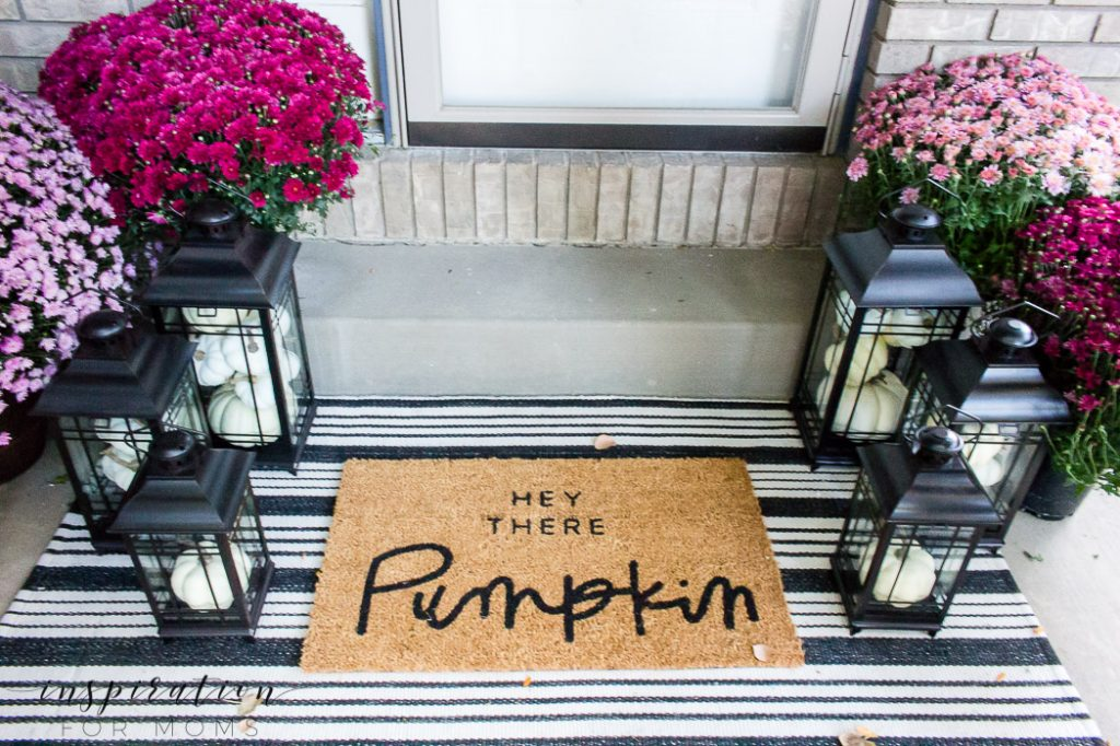 Freshen up your homes curb appeal with new layered mats and lanterns. #curbappeal