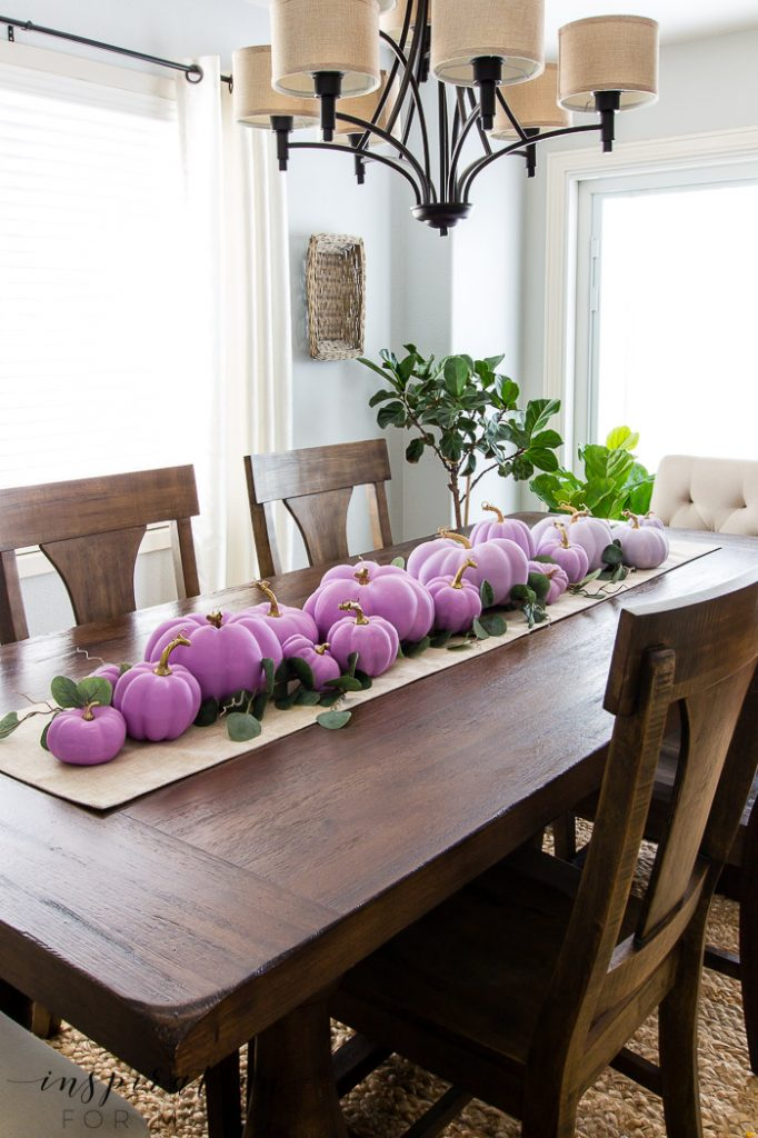 Create a fun fall centerpiece for anywhere in your home with a gathering of ombre painted pumpkins.
