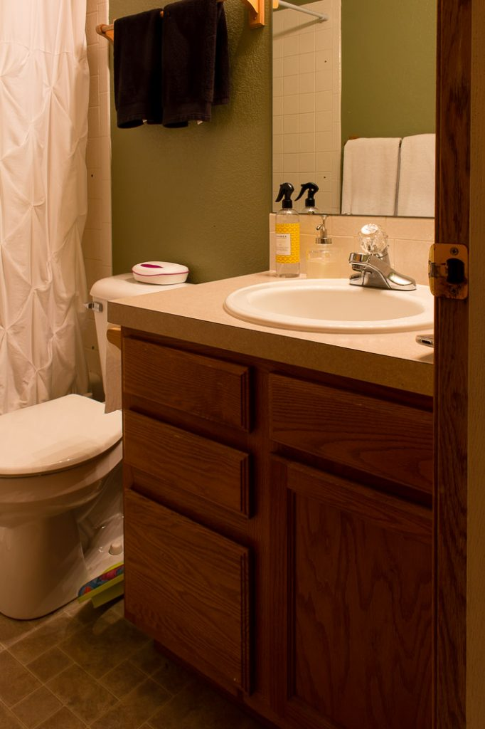 An outdated bathroom gets a new look with modern fixtures -- this is the before pic!