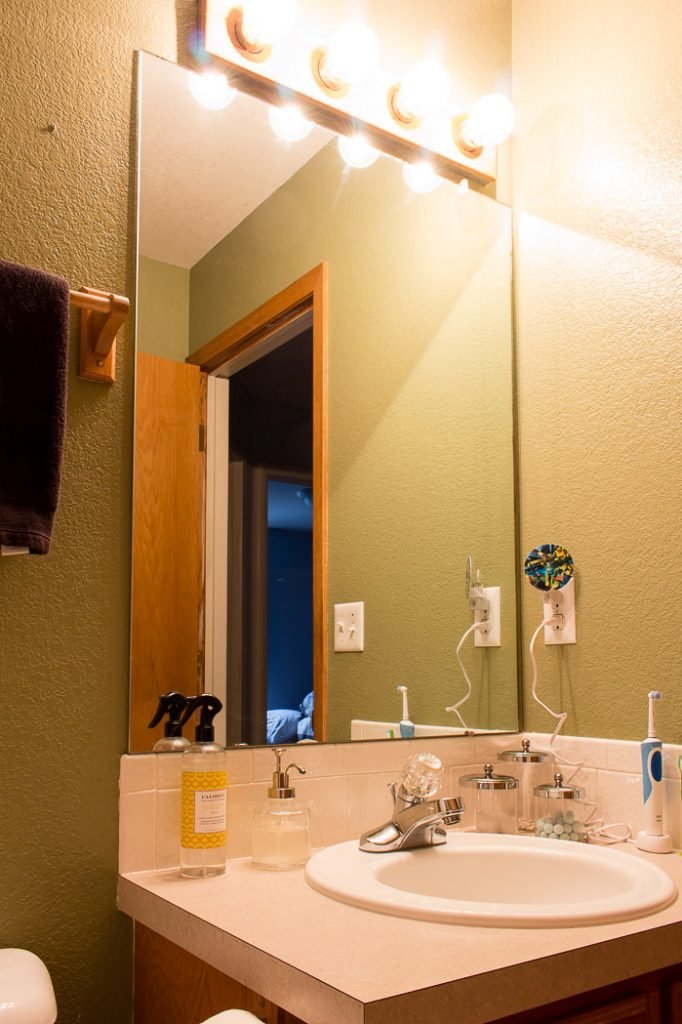 The sun is shining and it looks so good! Come see how our new VELUX skylights have dramatically changed our small bathroom remodel. #bathroomremodel