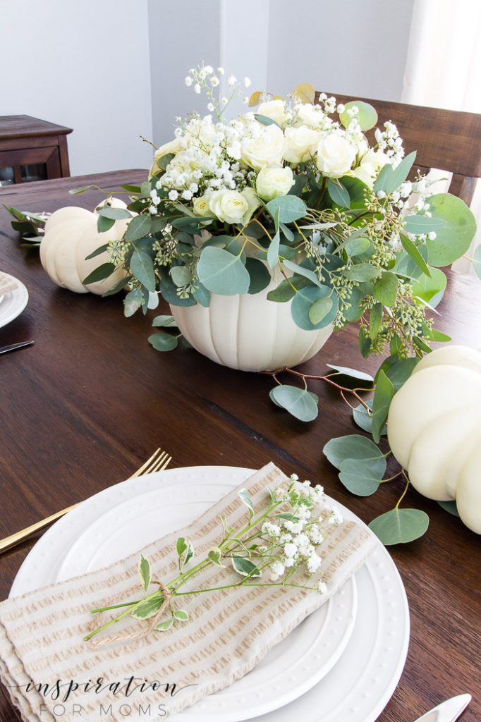 Create a simple but gorgeous pumpkin fall centerpiece for your dining table with this easy tutorial!