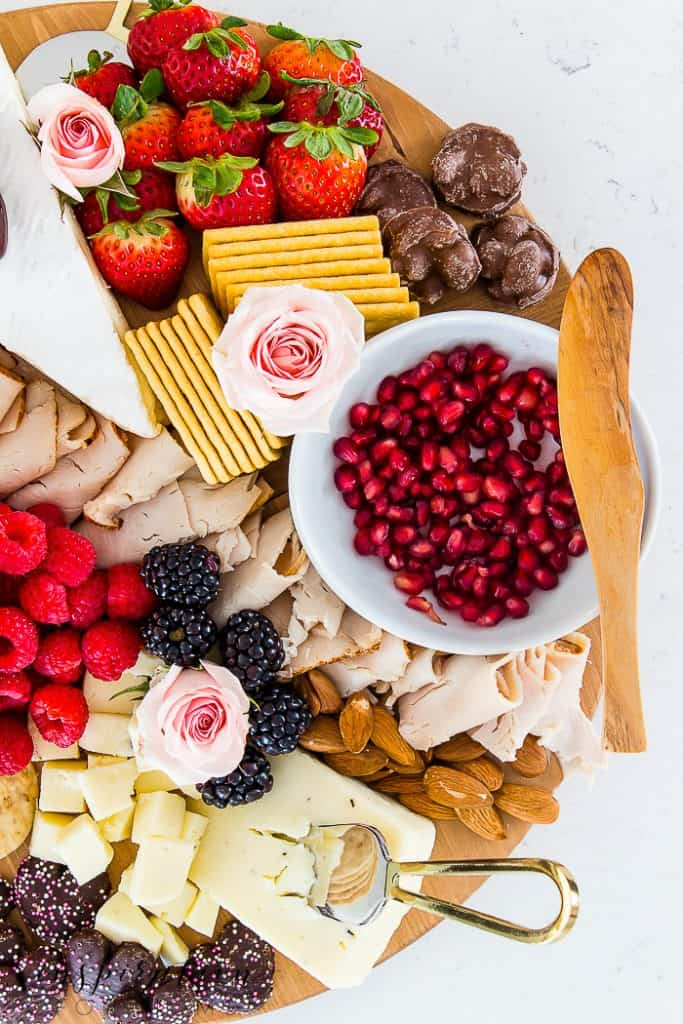 Create a simple Valentine's meal for your sweetie! This delicious date night meat and cheese charcuterie board has all the right ingredients for a special night!