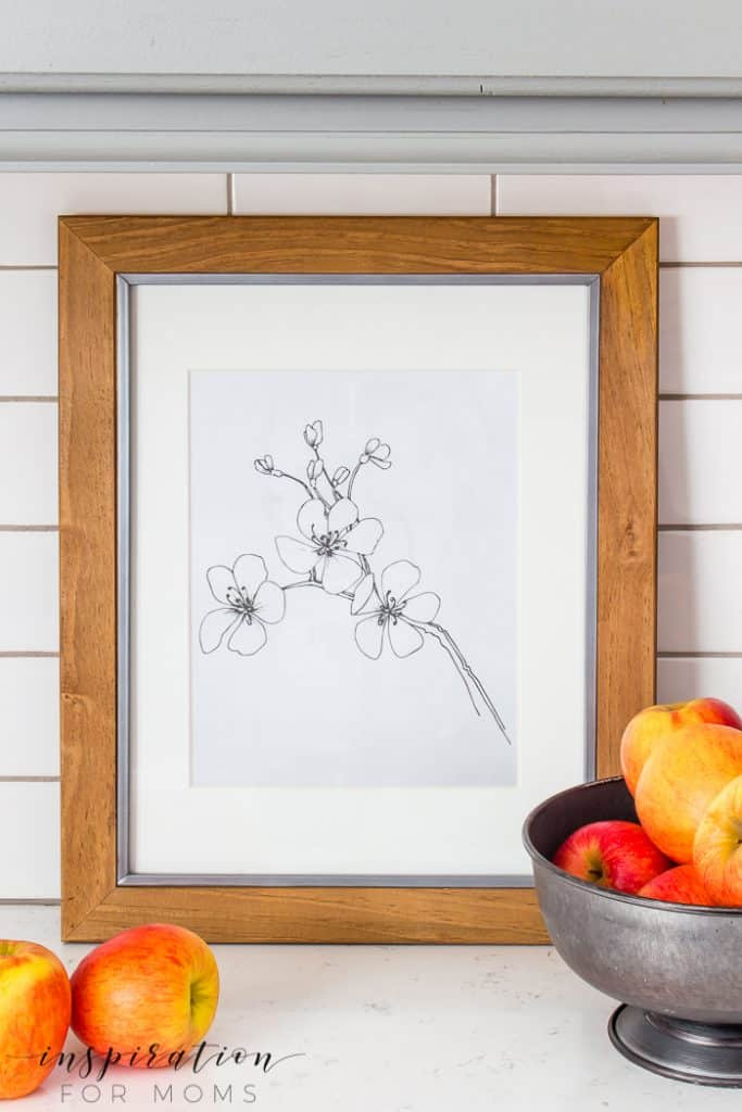 Add a little touch of simple art to your home decor with a spring flower sketch. Print both designs for free! #springprintable #freeprintable #springdecor