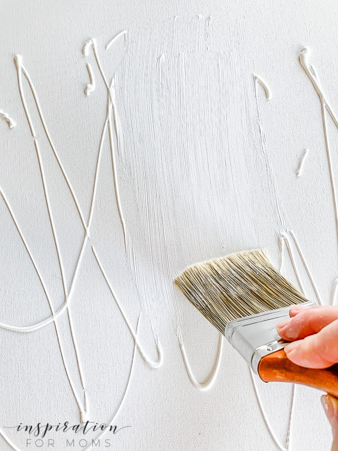 Art doesn't have to be expensive or complicated! Learn how to create a textured abstract art canvas for your home with this easy tutorial. #diycanvasart