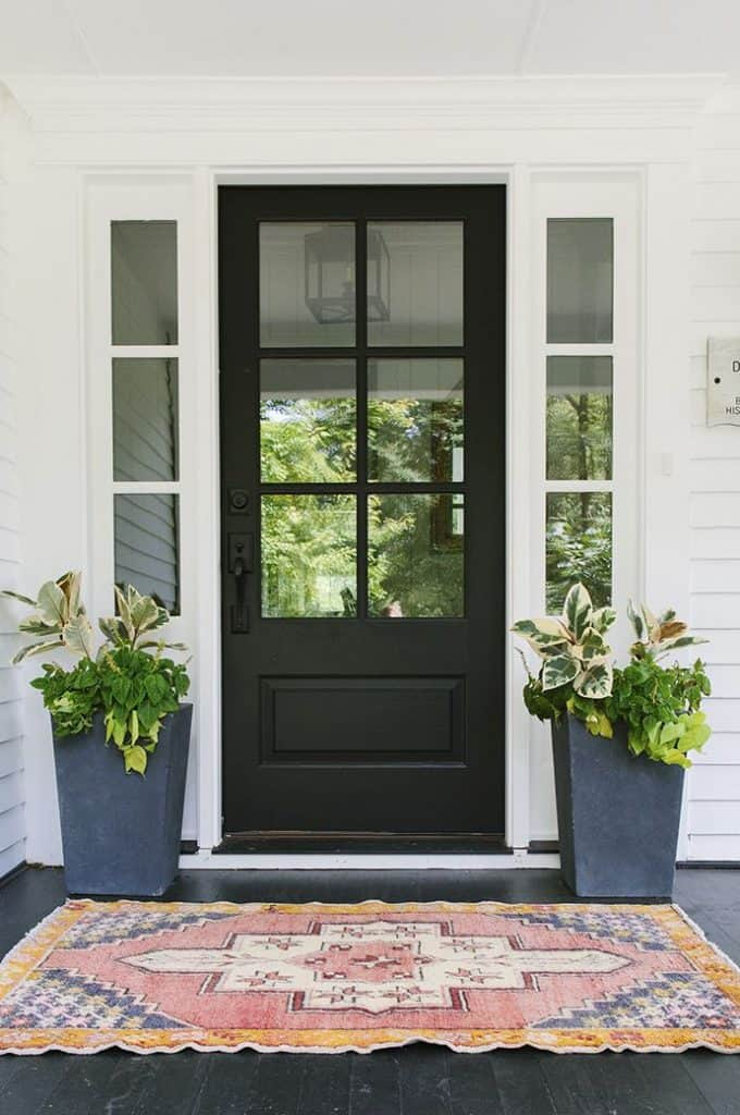 Freshen up your homes curb appeal with new door color - black. #curbappeal