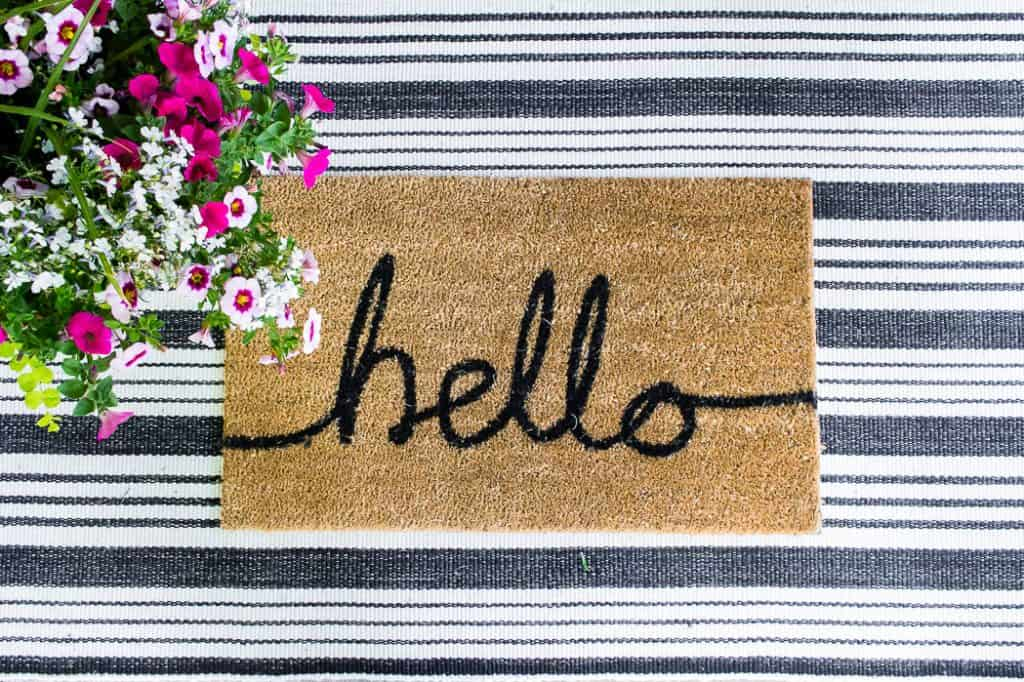 Freshen up your homes curb appeal with new layered doormats. #curbappeal