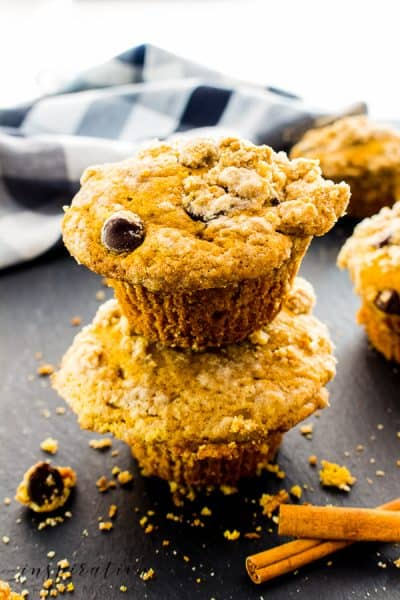 These delicious fall pumpkin coffee cake muffins are perfect for cool, fall days! Topped with a streusel crumb, they're irresistible! #pumpkinmuffin #falldessert #muffin