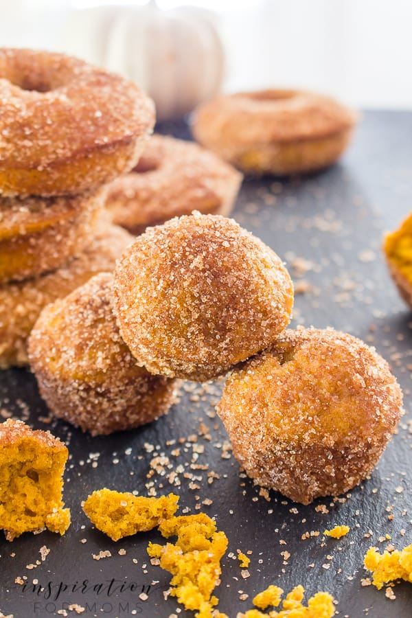 Scrumptious baked pumpkin cake donuts coated with melted butter and cinnamon sugar. The ultimate fall treat! #pumpkindonut #bakeddonut #cake