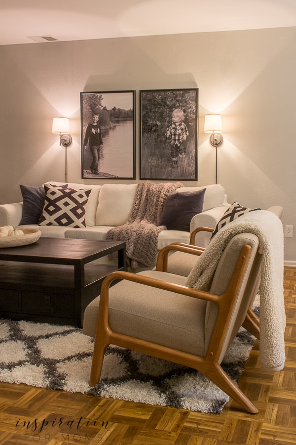 A cluttered room gets cleaned out and revamped. Come see the new & improved basement living room reveal! #basementlivingroom #basementreveal