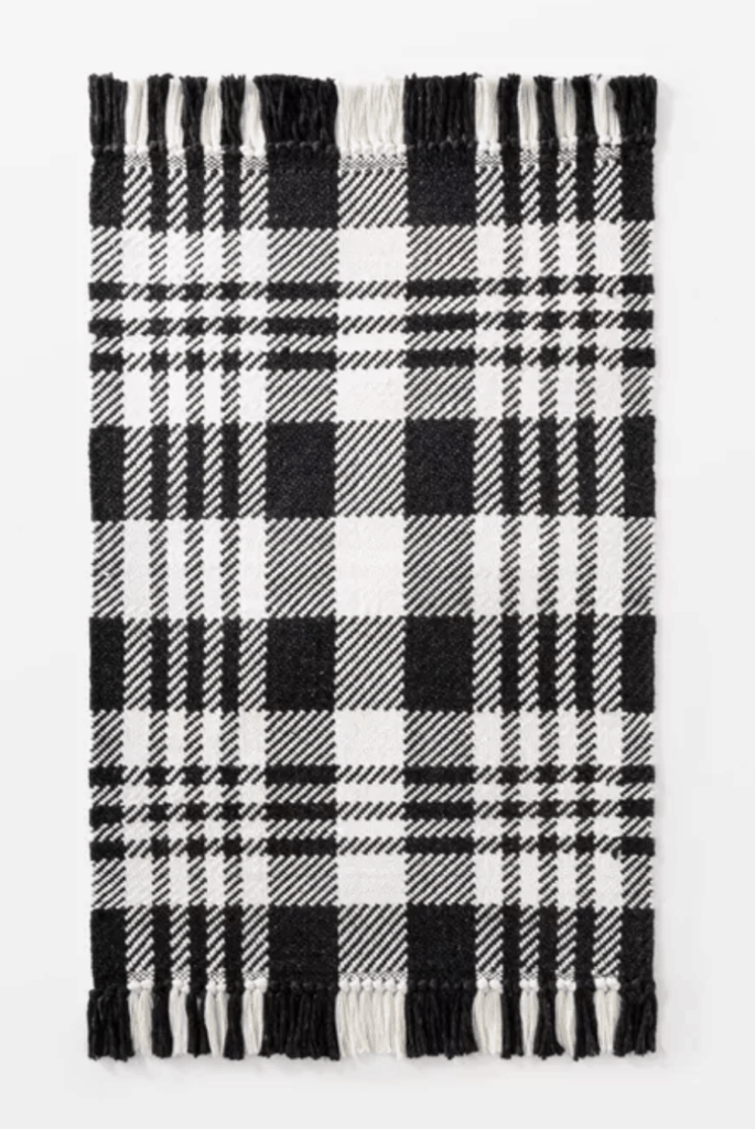 Plaid rug! Love the neutral black and white pattern
