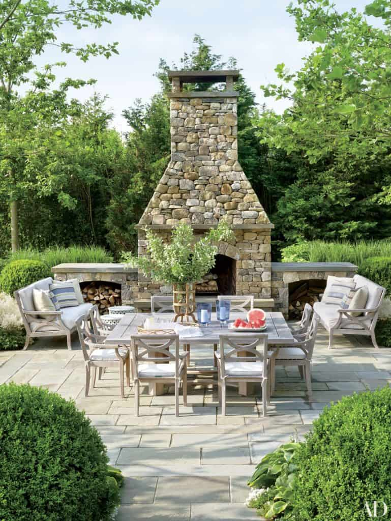patio dining area with outdoor stone fireplace
