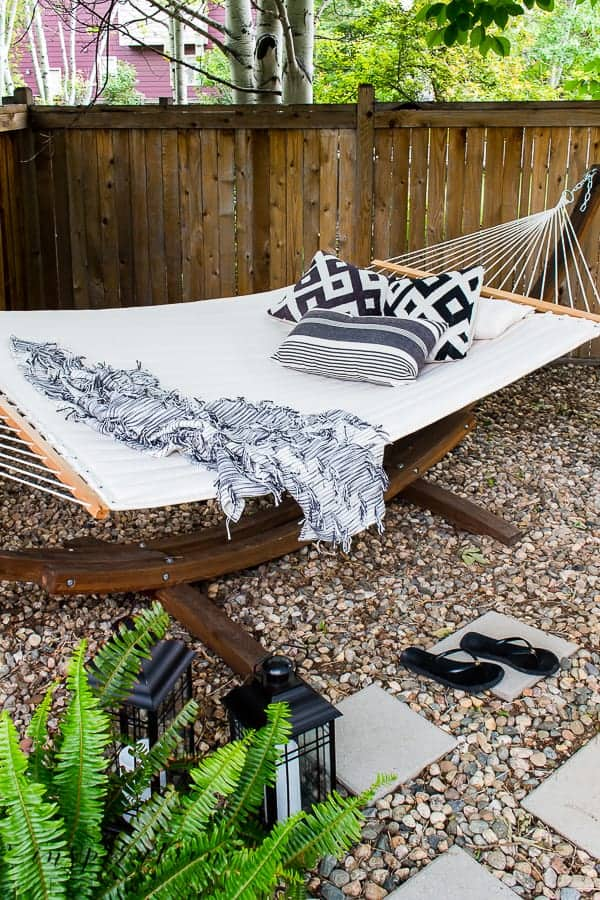 backyard hammock with black and white pillows and throw