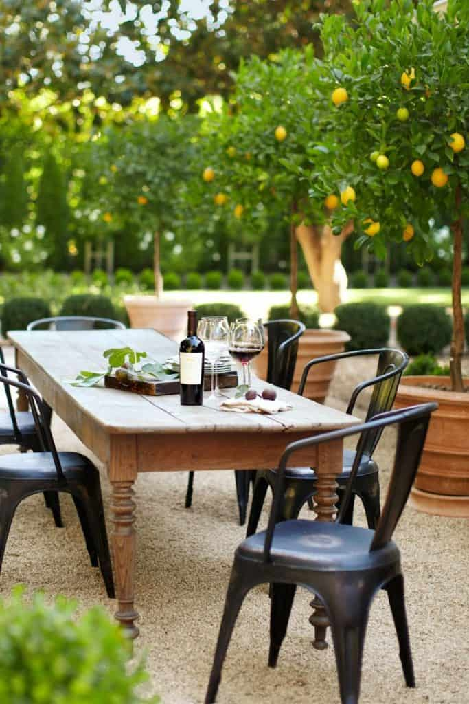 outdoor patio dining area with wood table and metal chairs