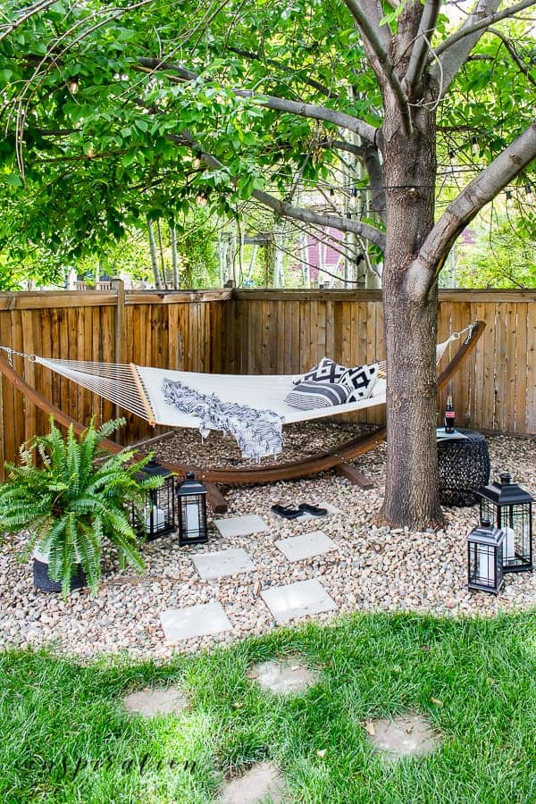 It's summer and everyone wants to live outside. So I've put together some of my best tips for outdoor entertaining! backyard hammock under tree in pea gravel