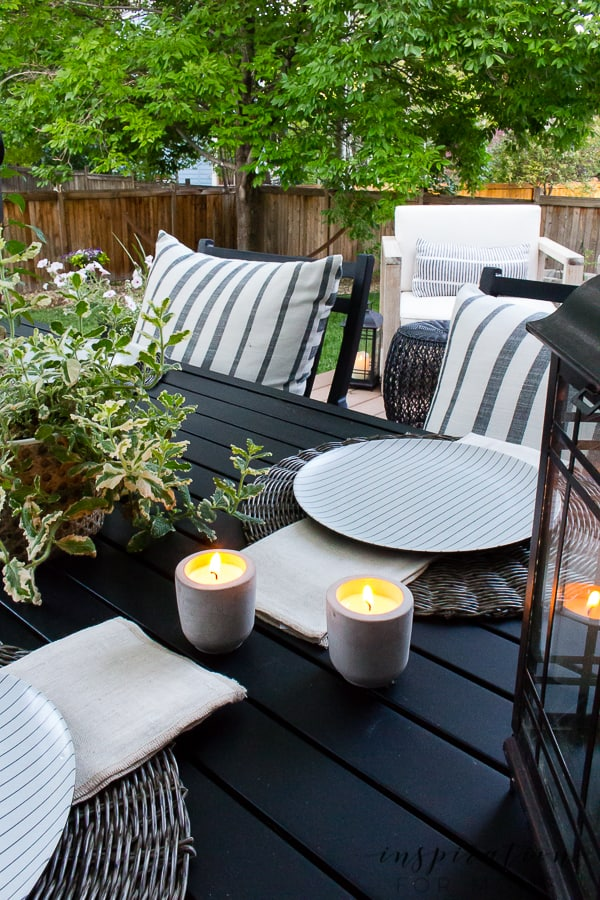 It's summer and everyone wants to live outside. So I've put together some of my best tips for outdoor entertaining! citronella candles on black patio dining table