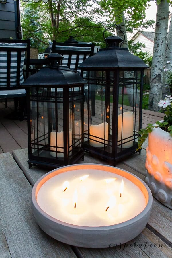 It's summer and everyone wants to live outside. So I've put together some of my best tips for outdoor entertaining! outdoor citronella candle and black lanterns