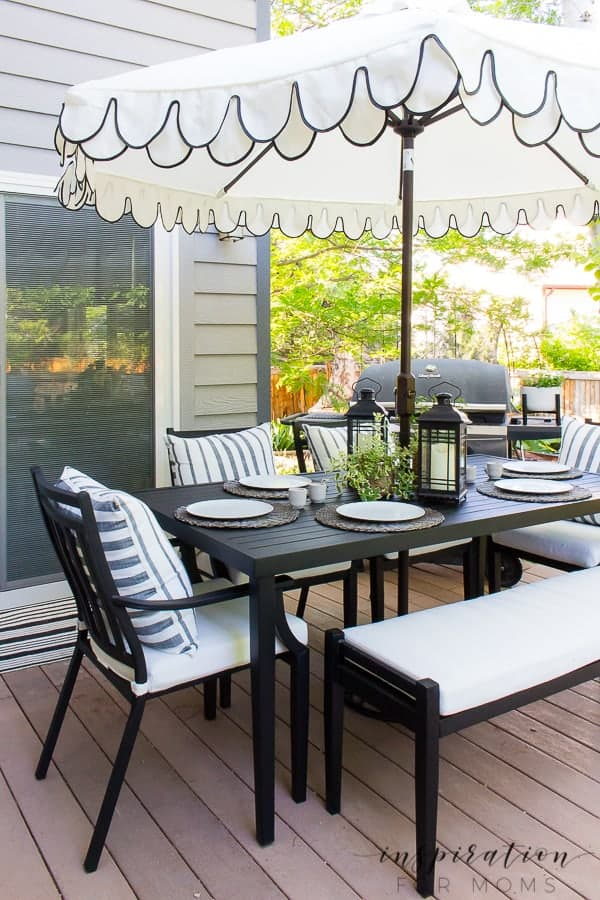 It's summer and everyone wants to live outside. So I've put together some of my best tips for outdoor entertaining! patio dining table with umbrella and chairs