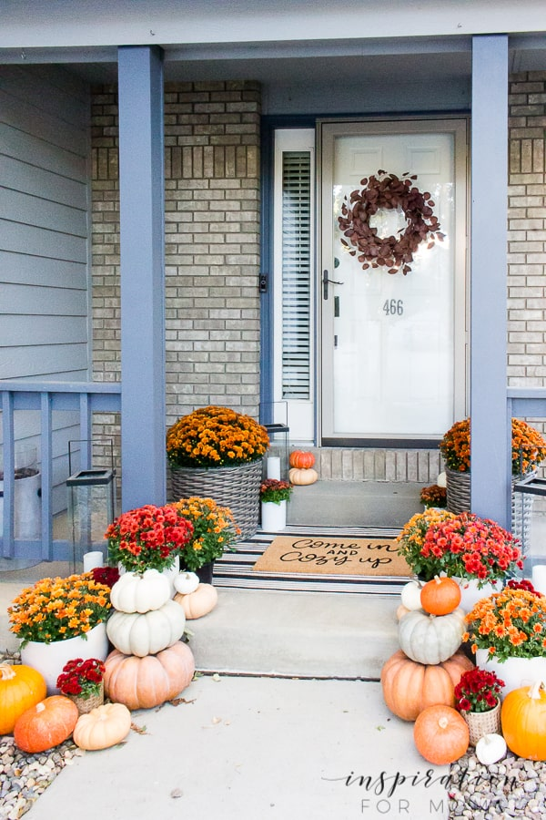 Fall decorating ideas can be as simple as a few mums and pumpkins. See how this front porch turned into a classic fall look! #falldecorating