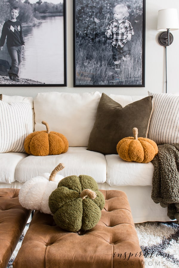 Learn how to create these adorable cozy pumpkin pillows with absolutely no sewing. These pumpkin pillows are the perfect fall accessory!